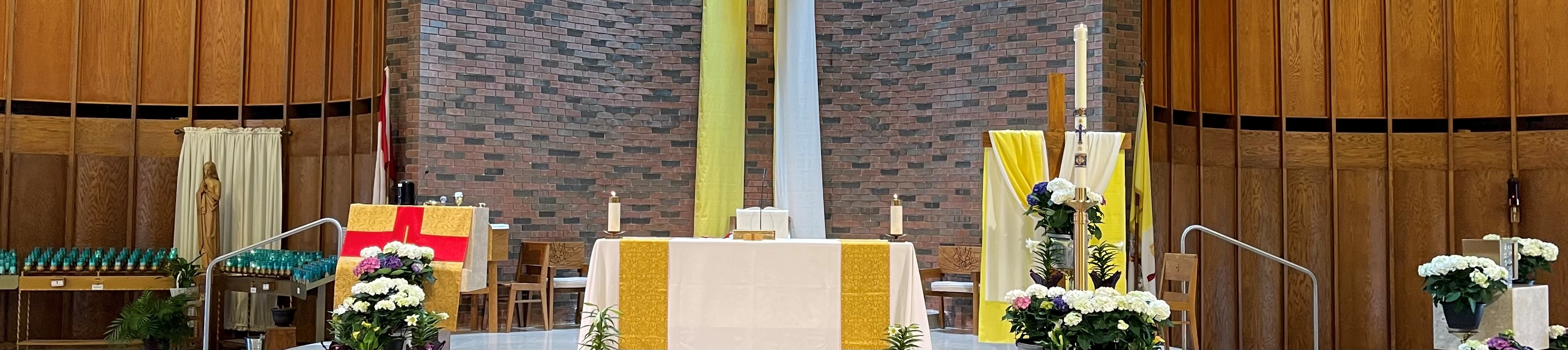 Altar of St Mary's with Gold decor and Easter flowers