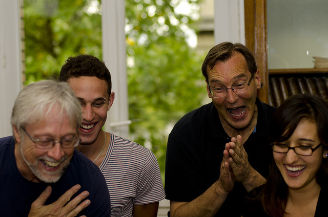 Group of 4 people laughing